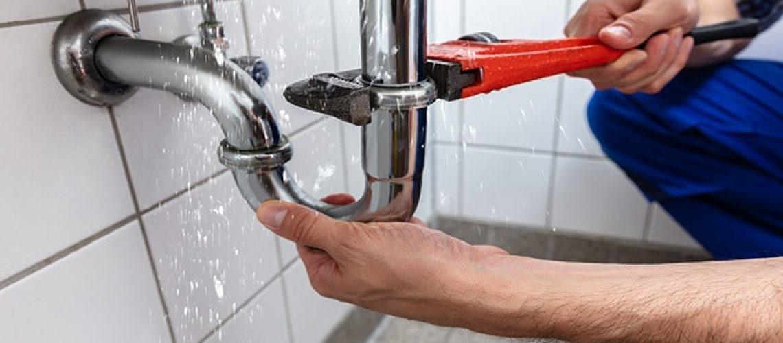 Plumber Repairing Sink Pipe Leakage
